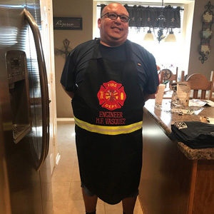 Firefighter wearing firefighter apron